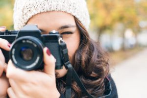 Close up of a woman with a camera